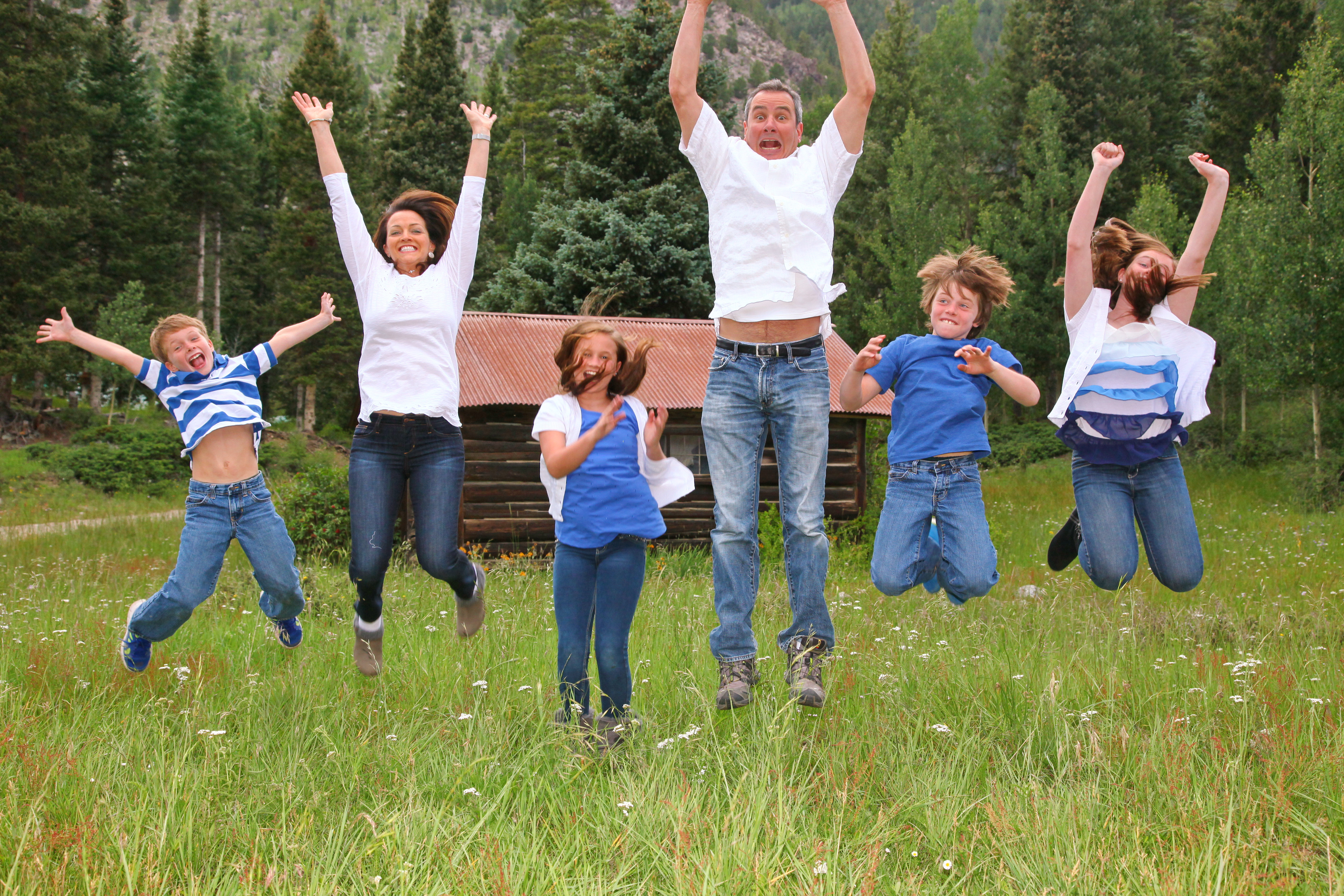 Kids jumping in front of mountains- Southern Exposure Photography